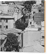 looking down over rooftops to ledra street crossing and  restricted area of the UN buffer zone  Wood Print
