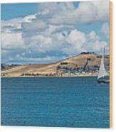 Luxury Yacht Sails In Blue Waters Along A Summer Coast Line Wood Print