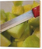 Macro Photo Of Knife Over Bowl Of Cut Musk Melon Wood Print