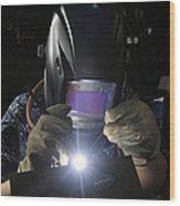 Maintenance Technician Uses A Tig Wood Print
