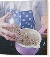 Making Porridge From Oats Wood Print by Veronique Leplat