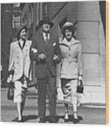 Man And Two Women Walking On Sidewalk, (b&w) Wood Print by George Marks