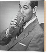 Man Drinking Water From Glass, Posing In Studio, (b&w), Portrait Wood Print by George Marks
