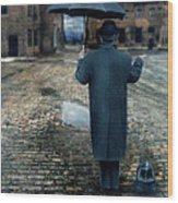 Man In Vintage Clothing With Umbrella On Rainy Brick Street Wood Print