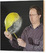 Man Popping A Balloon Wood Print