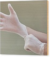 Man Putting On Latex Gloves Wood Print by
