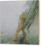 Man Reefing Mainsail In Heavy Weather Wood Print