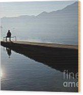 Man Sitting On The Pier Wood Print