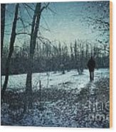 Man Walking In Snow At Winter Twilight Wood Print by Sandra Cunningham