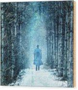 Man Walking Through Snowy Woods Wood Print