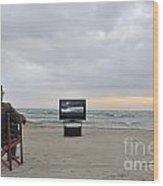 Man Watching Tv On Beach At Sunset Wood Print