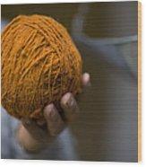 Mans Hand Holds Ball Of Orange Wool Wood Print