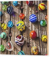 Marbles On Wooden Board Wood Print