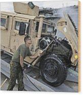 Marine Uses A Pressure Washer To Clean Wood Print