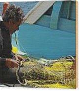 Mending His Nets Wood Print