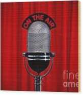 Microphone On Stage With Spotlight On Red Curtain Wood Print by Richard Thomas