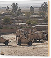 Military Vehicles Parked Outside Loy Wood Print