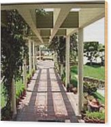 Mix Of Light And Shade Under A Partially Covered Pathway With Pillars Wood Print