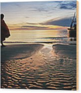 Monk Walk For Food On The Beach Wood Print by Arthit Somsakul
