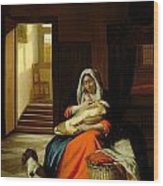 Mother Nursing Her Child Wood Print