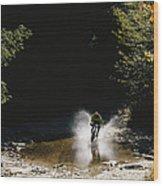 Mountain Biker Splashing Through Water Wood Print
