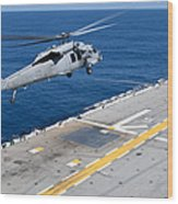 N Mh-60s Sea Hawk Helicopter Lifts Wood Print