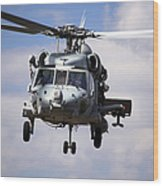 Navy Pilots In A Sh-60f Seahawk Conduct Wood Print