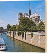 Notre Dame Cathedral Along The Seine River Wood Print