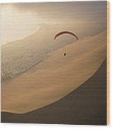 Ocean Gusts Keep A Paraglider Aloft Wood Print