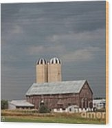 Ominous Clouds Over The Barn Wood Print by J McCombie