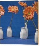 Orange Gerberas Against Blue Wood Print