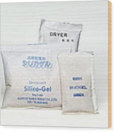 Packets Of Silica Gel Wood Print by Paul Rapson