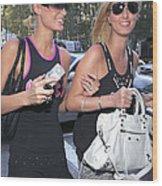 Paris Hilton, Nikki Hilton Carrying Wood Print