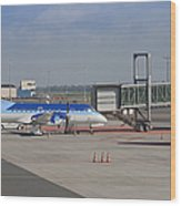 Parked Airplane At An Airport Gate Wood Print by Jaak Nilson