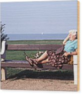 Pensioner Relaxing On A Bench Wood Print