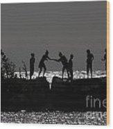 People Walking On Rocks By The Water Wood Print