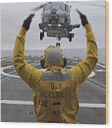 Petty Officer Guides An Sh-60r Sea Hawk Wood Print