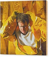 Pharmaceutical Worker Putting On A Protective Suit Wood Print