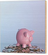 Piggy Bank On Pile Of Coins Wood Print