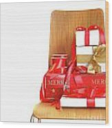 Pile Of Gifts On Wooden Chair Against White Wood Print