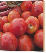 Pile Of Red Luscious Tomatoes Along With Carrots On A Vegetable Basket Wood Print