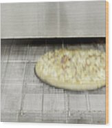 Pizza Coming Out Of The Oven Wood Print by Magomed Magomedagaev