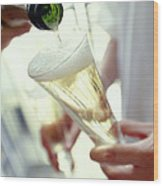Pouring Champagne Wood Print by David Munns