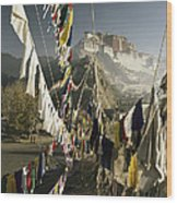 Prayer Flags Hang In The Breeze Wood Print