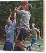 President Barack Obama Plays Basketball Wood Print by Everett