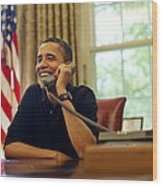 President Barack Obama Talks By Phone Wood Print by Everett