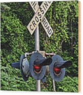 Railroad Crossing Light And Greenery Wood Print