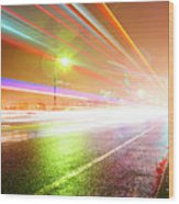 Rainy Road With Blurred Traffic At Night Wood Print