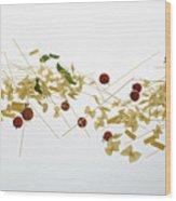 Raw Pasta, Tomatoes, And Basil Against A White Background Wood Print
