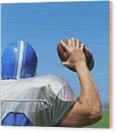 Rear View Of A Football Player Throwing A Football Wood Print